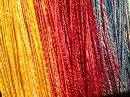 Hand spun fibre from Holori's Magical Yarnorium. Colourway is 'Jupiter's Eye'